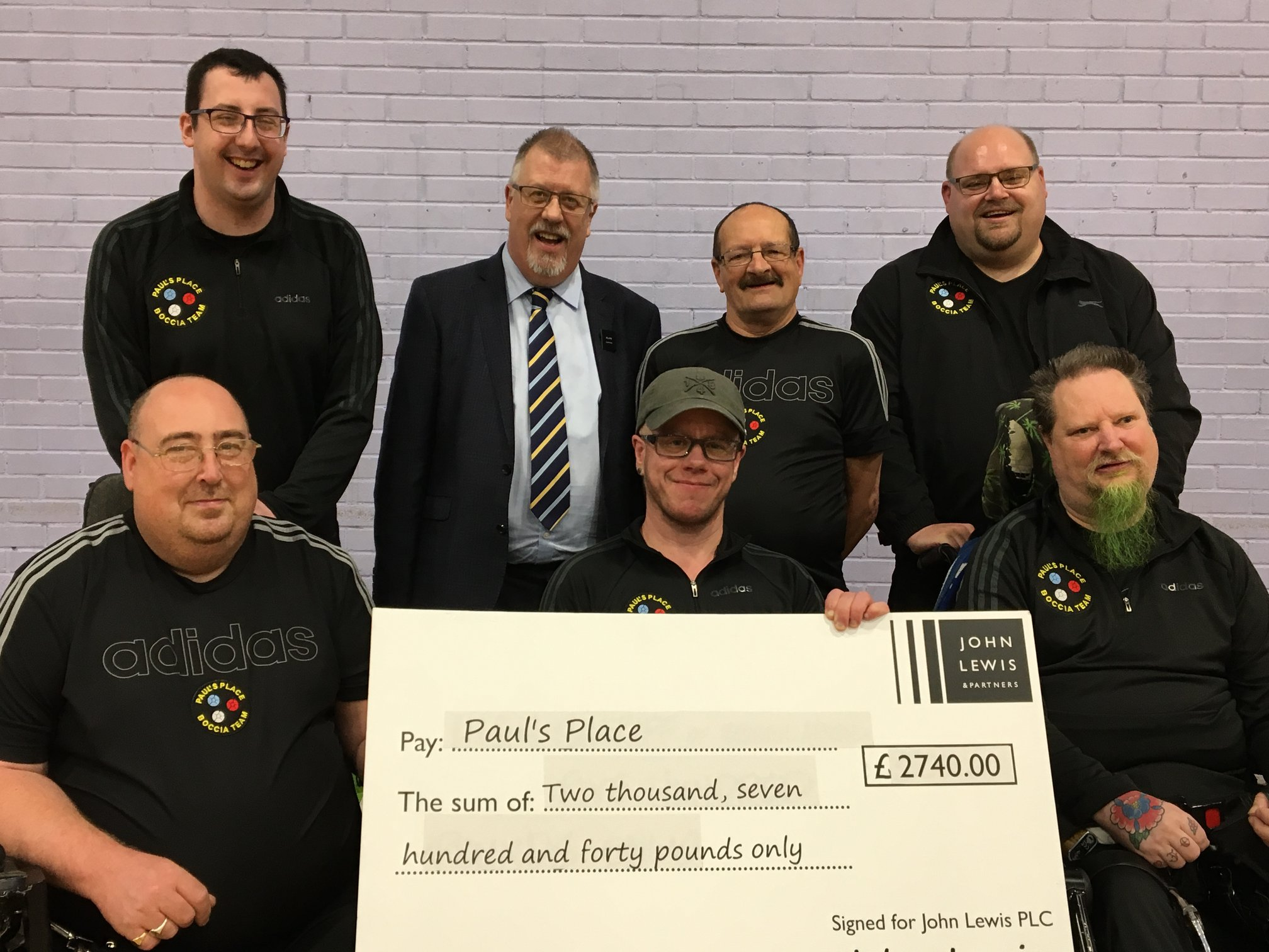 Boccia players with a John Lewis cheque