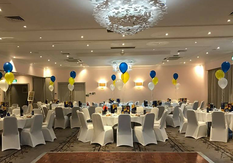 Pauls Place Anniversary Ball 2019. Tables set for dinner with balloons.