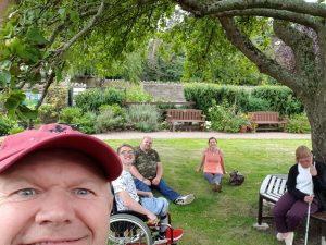 Support worker andy with 3 service users in the Park