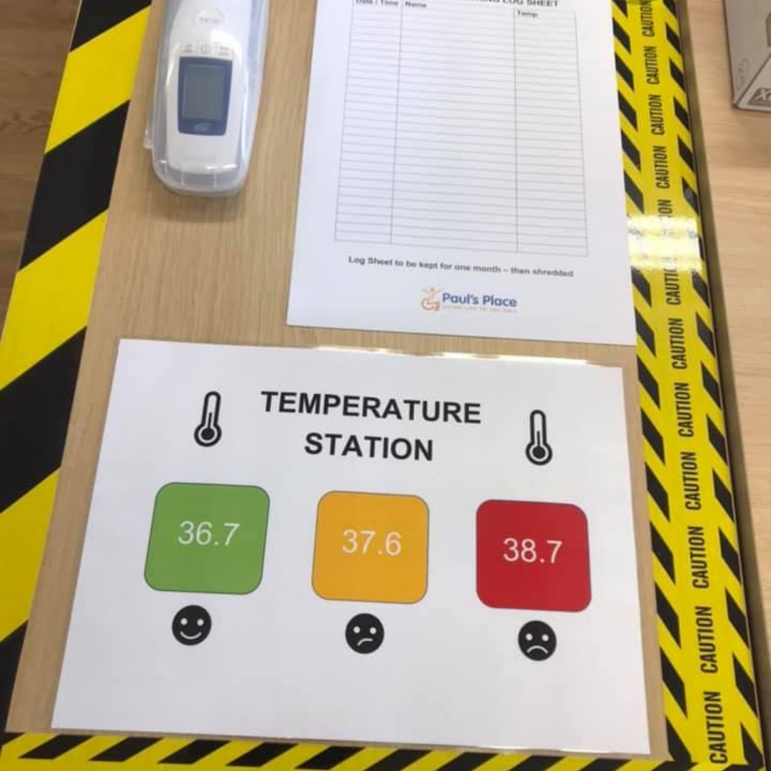 Image of temperature checking station with 3 squares. 1 green, 1 yellow and 1 red to indicate safety.