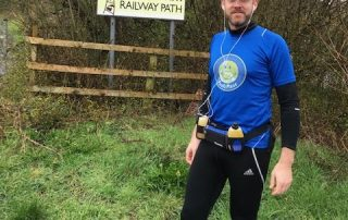 Daniel Curl standing infront of the bristol to bath railway path sign