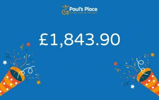 £1,843.90 in big white writing on a blue background with confetti cannons either side of the number